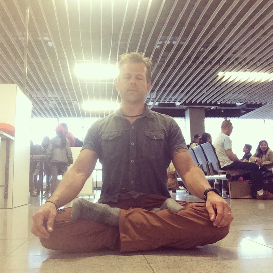 Coach Jeff Grant meditation practice at a crowded airport